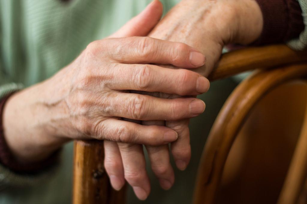 Hands with Rheumatoid Arthritis men's health concerns over 40