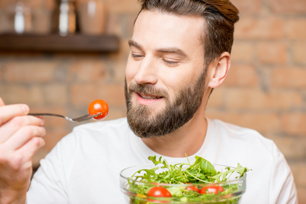 Man Eating Tomato Anti-Aging