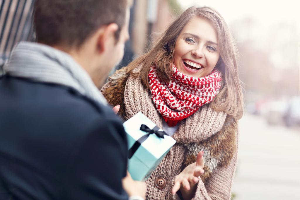Man Giving Woman Gift Romance