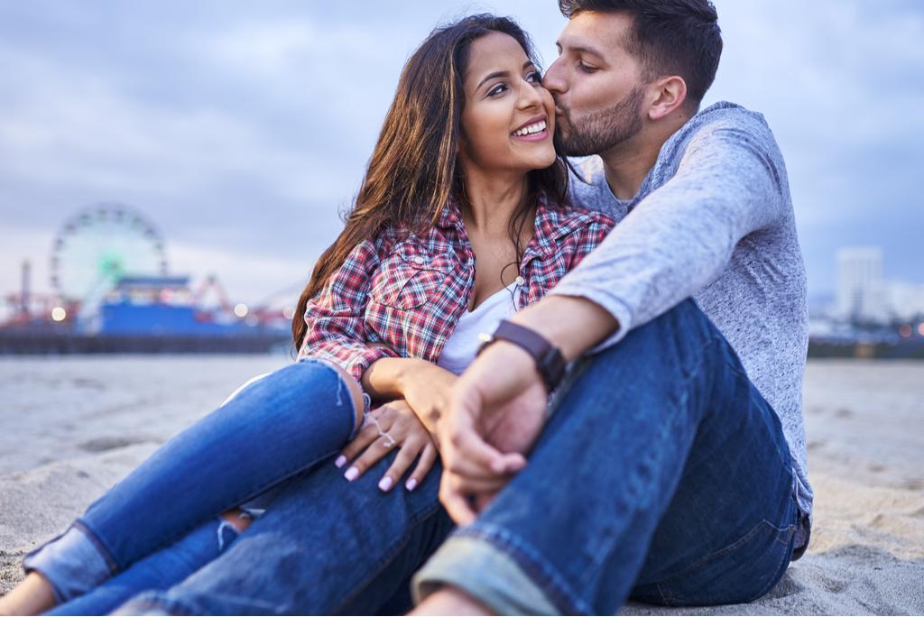 Man Giving Woman Kiss on Cheek Romance