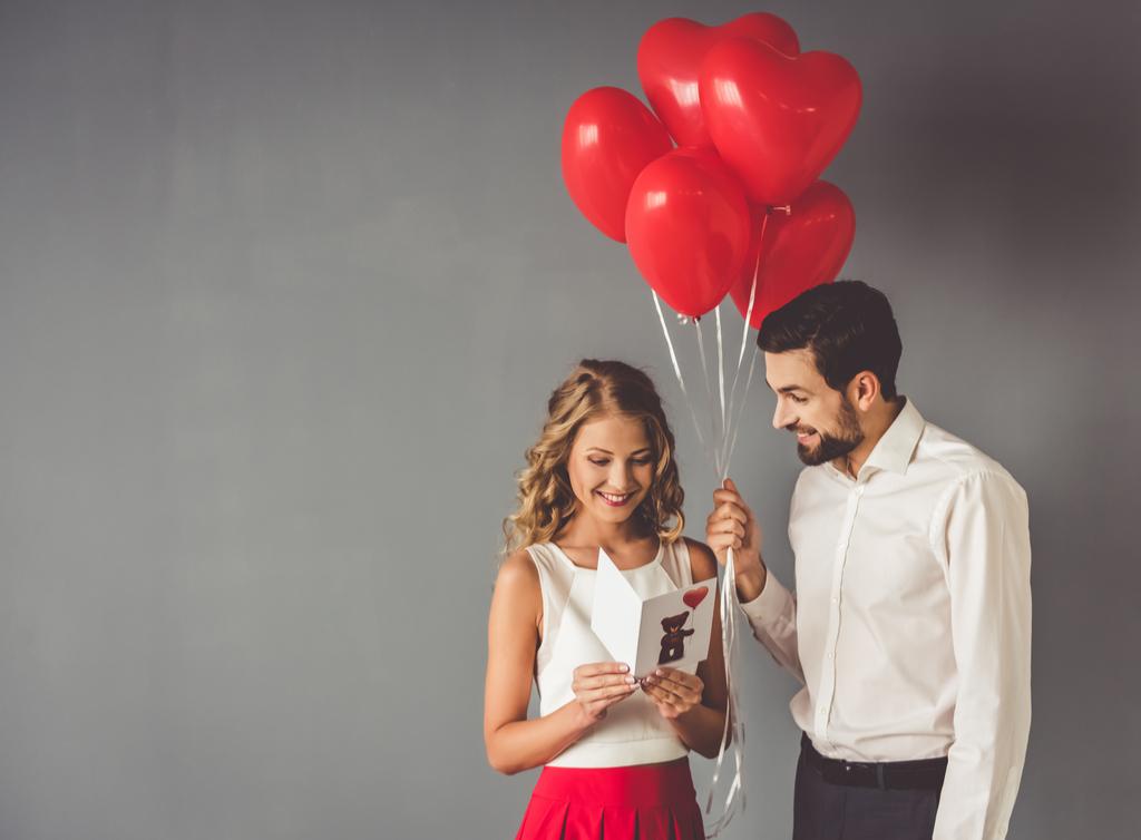 Man Surprising Woman with Balloons Romance