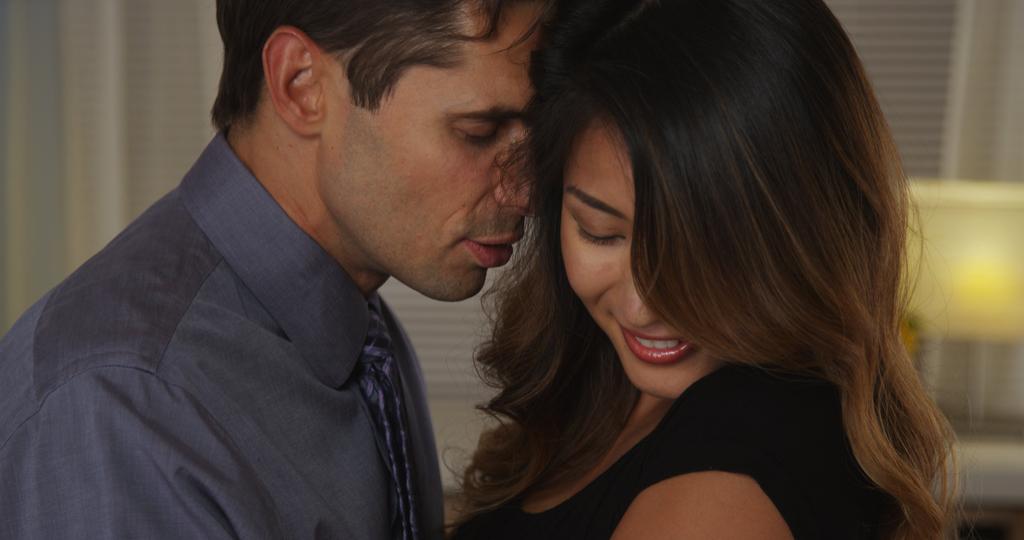 Man Whispering in Woman's Ear Romance social media cheating
