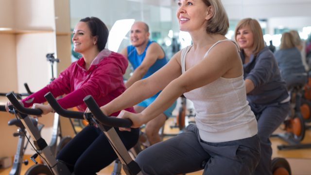 Older Woman on Exercise Bike weight loss after 60
