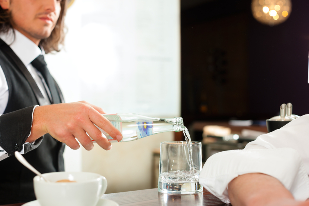 Waiter Pouring Water