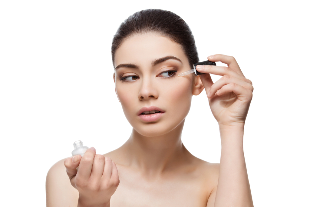 Woman Applying Serum to Skin Anti-Aging Tips You Should Forget