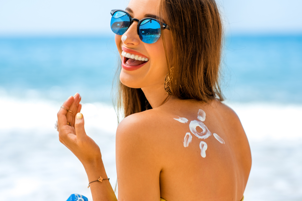 Woman Applying Sunscreen Regrets