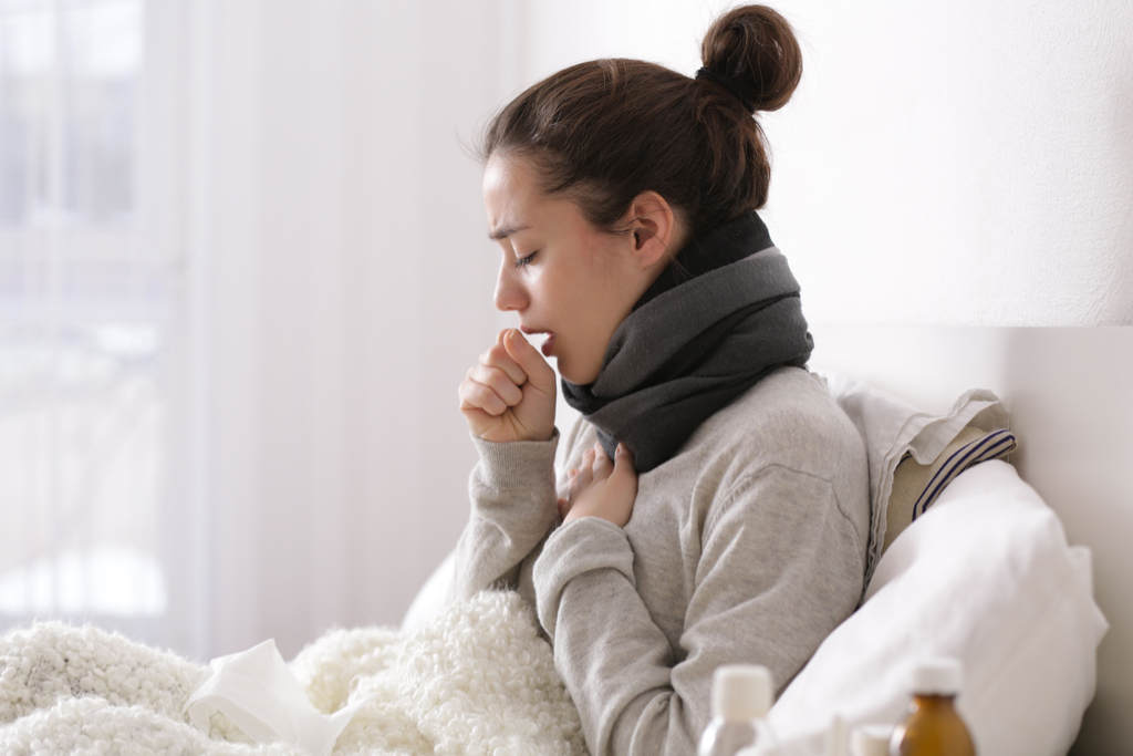 Woman Coughing in Bed 50 amazing things your body tells you