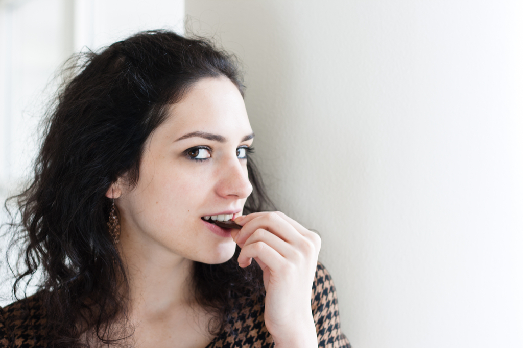 Woman Eating Dark Chocolate Prevent Heart Disease