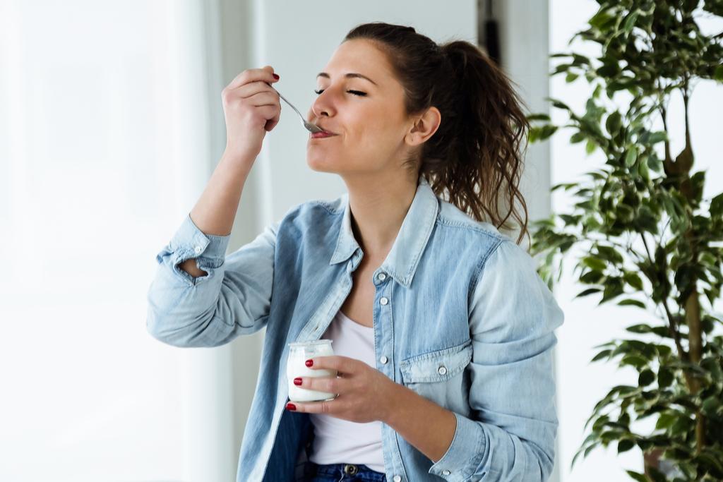 Woman Eating Yogurt Anti-Aging