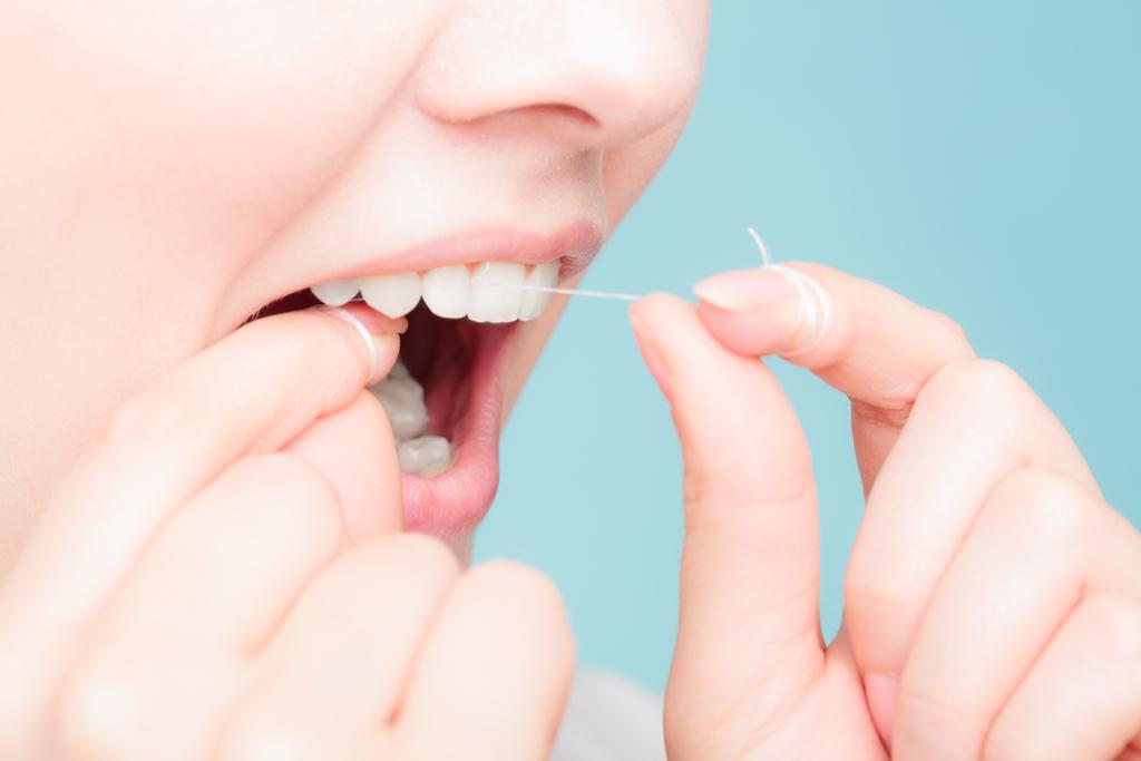 Woman Flossing Teeth Prevent Heart Disease