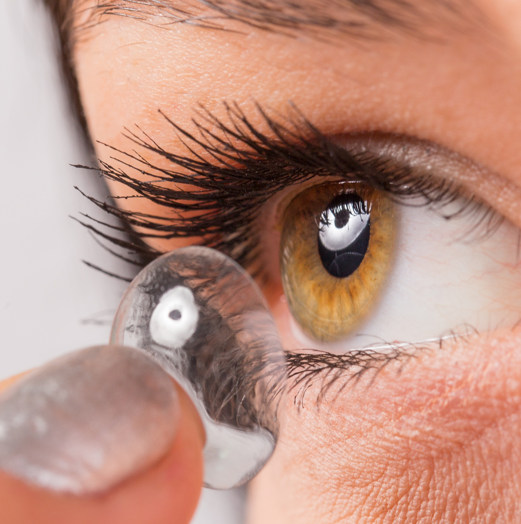 woman putting in contacts gross everyday habits