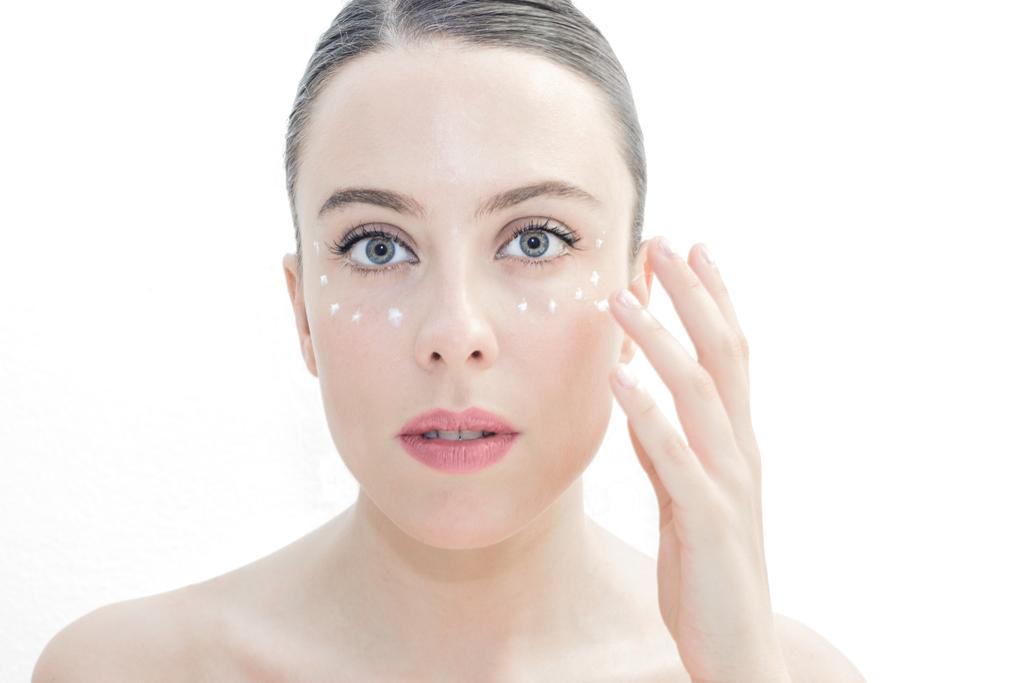 Woman Applying Eye Cream Anti-Aging Tips You Should Forget