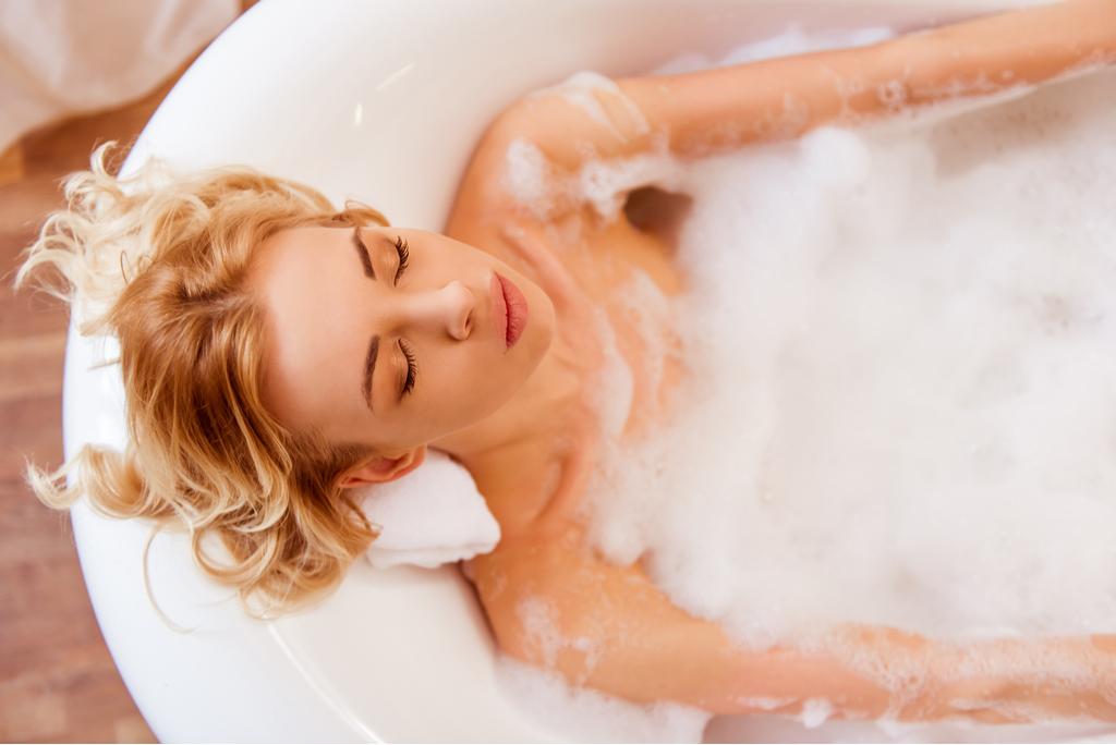 Woman Resting in Bubble Bath