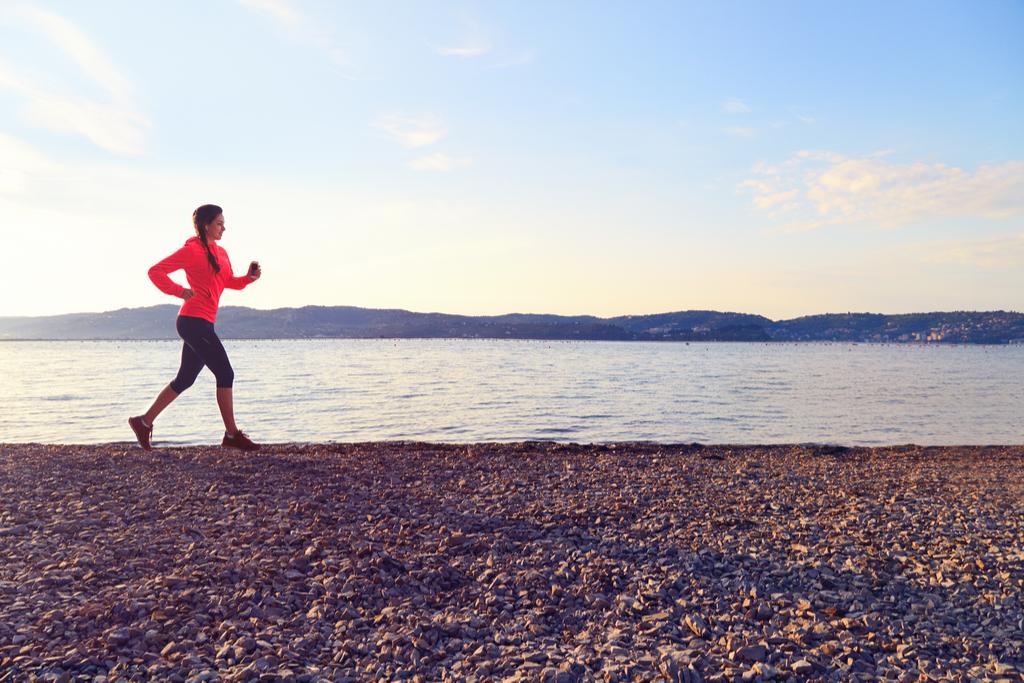 Woman Running Near Water Anti-Aging