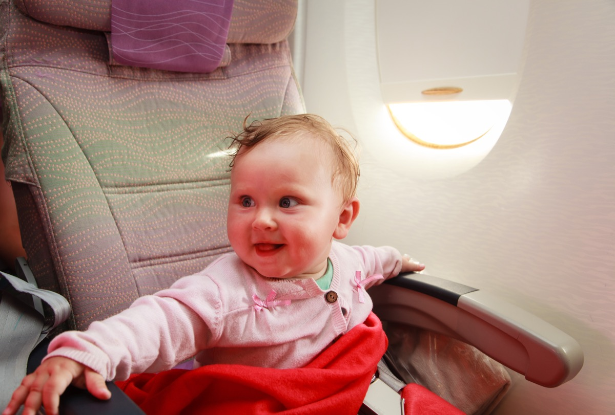 baby smiling on airplane