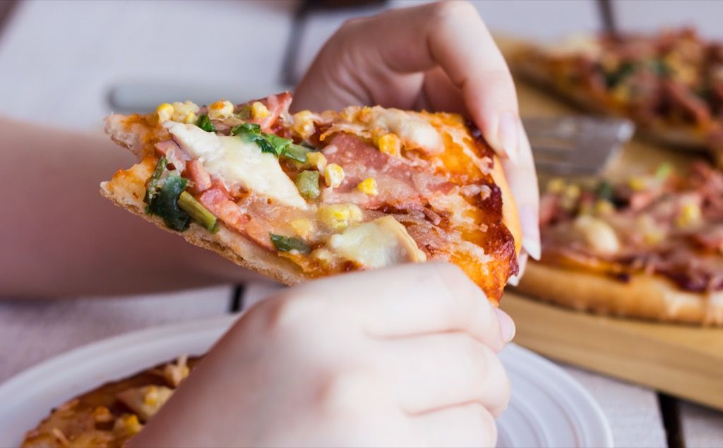 woman eating pizza advice you should ignore over 40