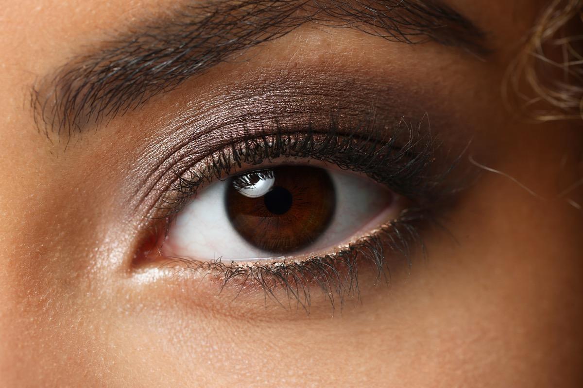 Eye of a black woman shot large macro - Image