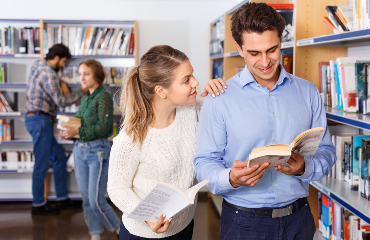 Couple reading books at the bookstore or library