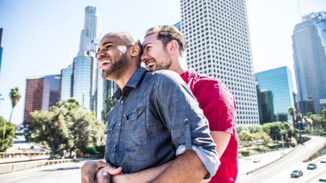 Gay couple enjoying a date in the city outside