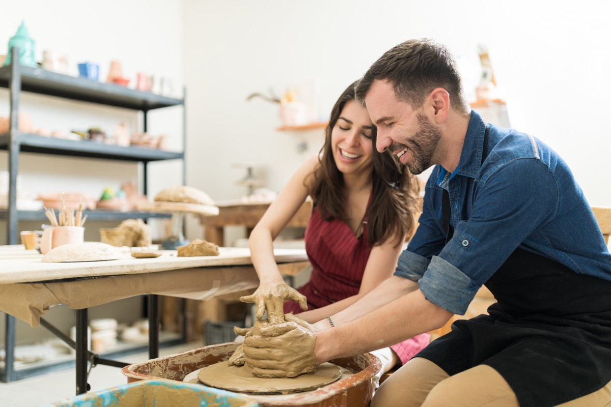 Couple taking a pottery class together