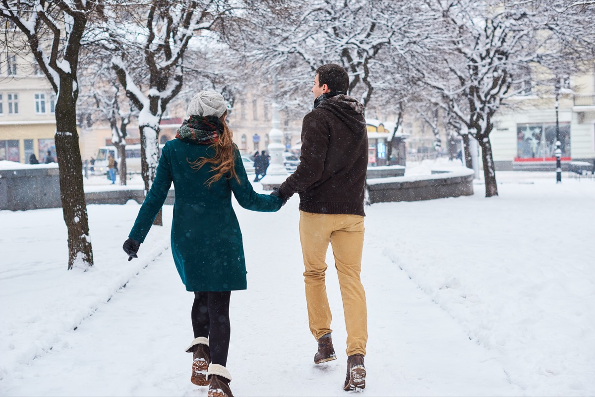Cute couple having a good time outside in the snow