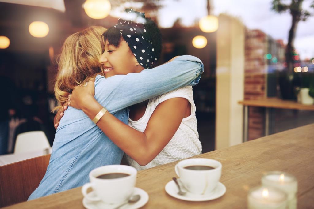 demisexual woman embraces friend