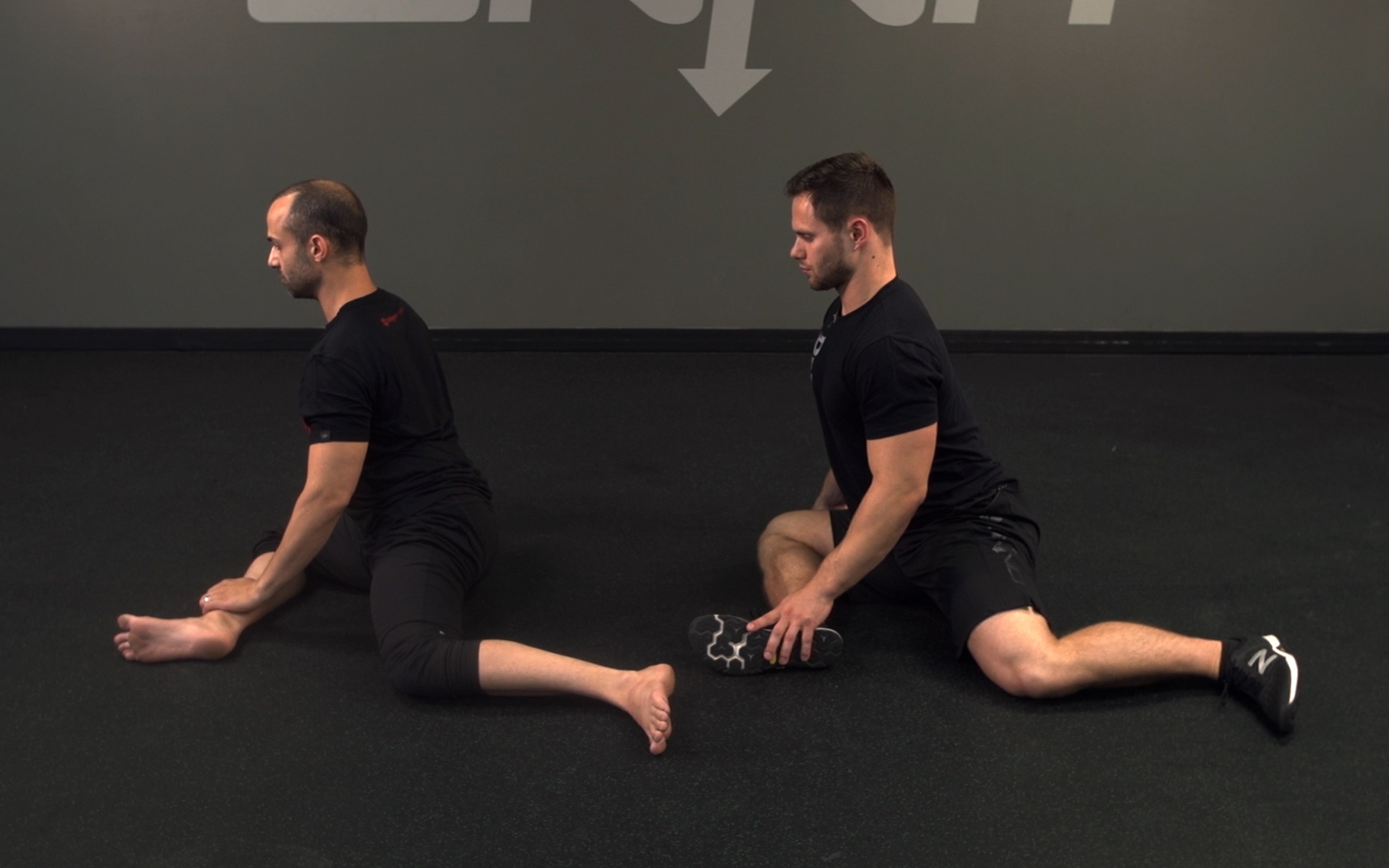two men show 90/90 exercise for hip joint flexibility.