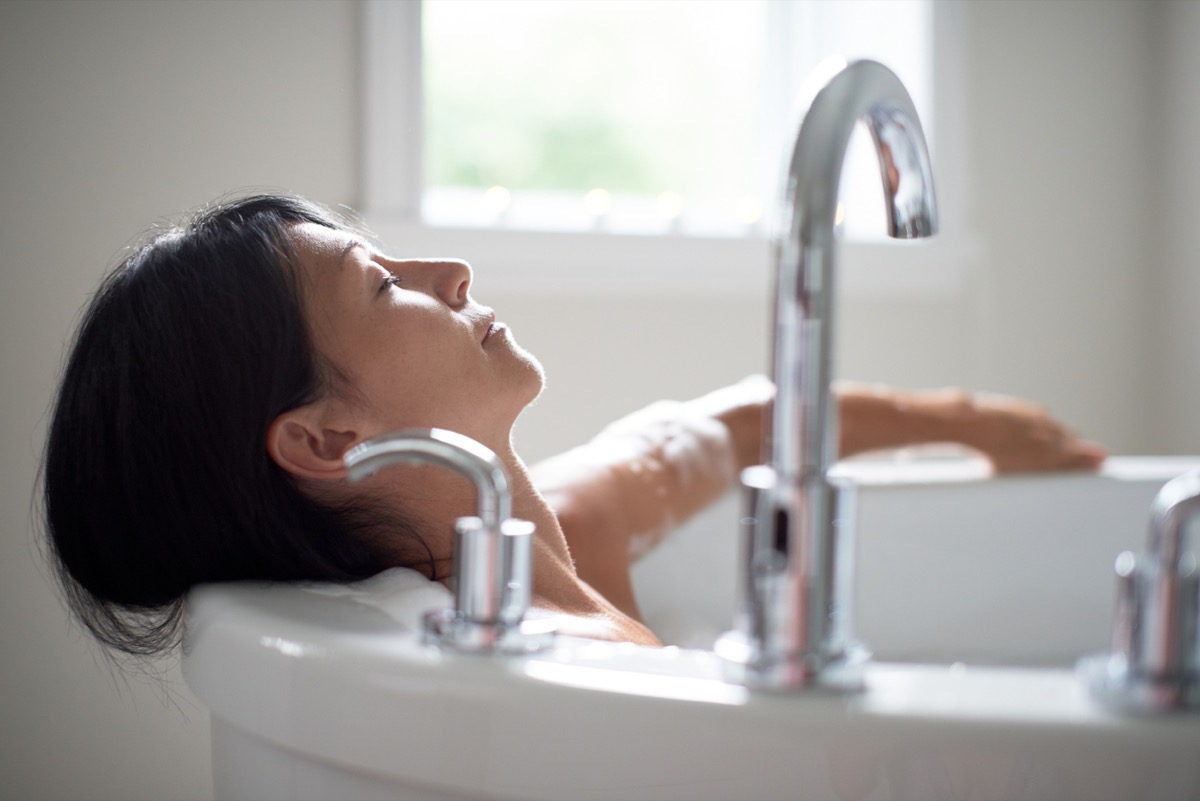 close up of middle aged white woman taking a bath