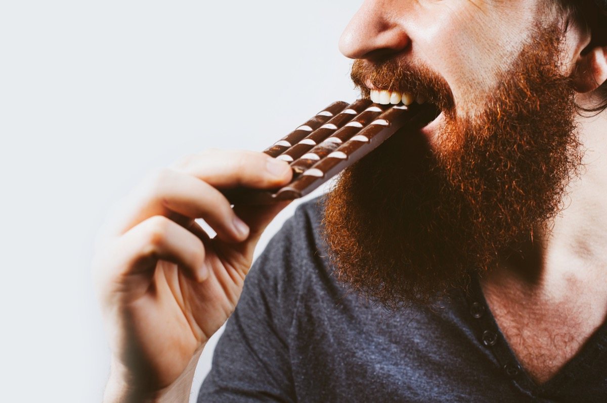 Man with a bar of chocolate
