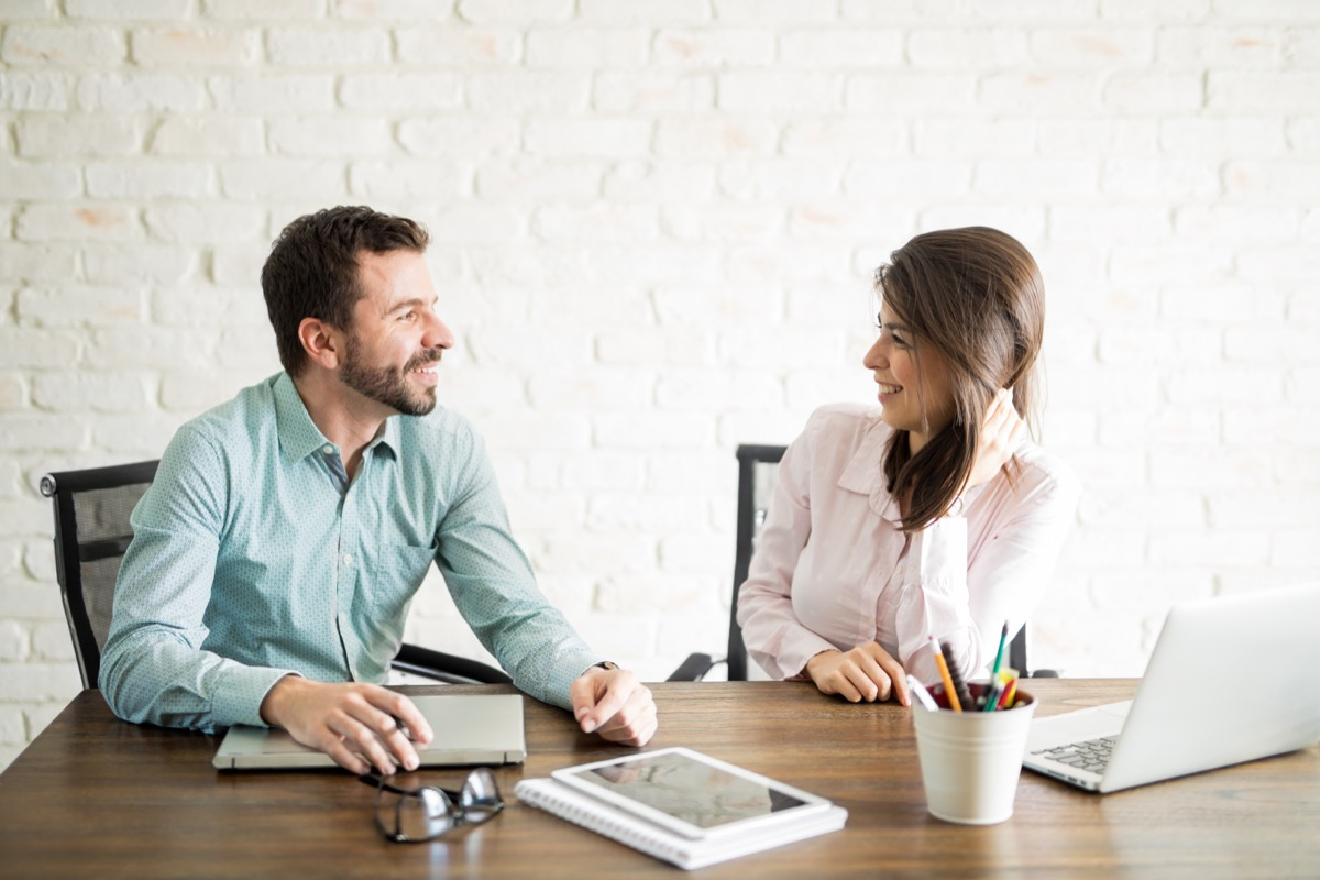 man and woman flirting in an office