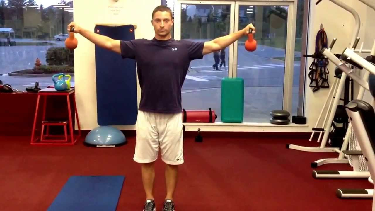 man performs dumbbell iso-holds