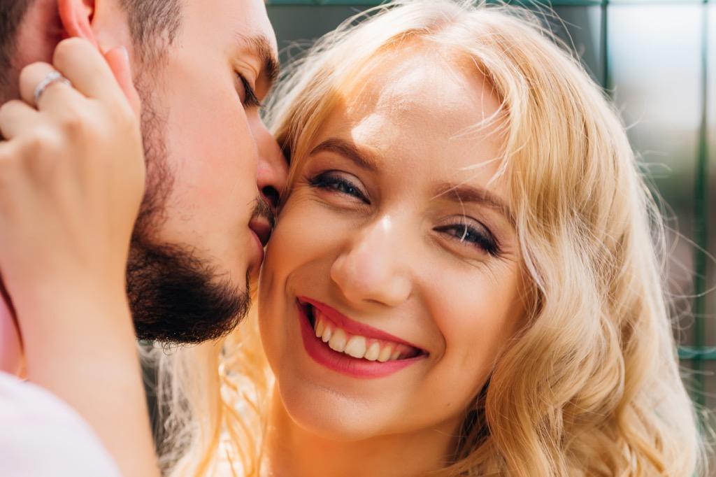 Woman getting kiss