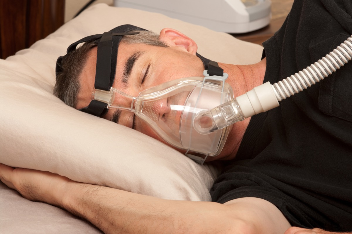 middle aged white man in cpap mask for sleep apnea