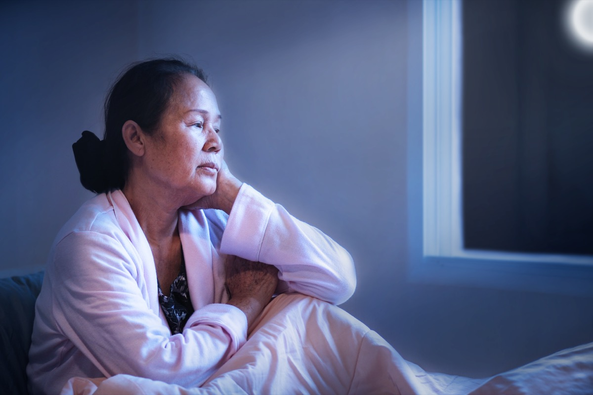 middle aged woman awake in bed at night
