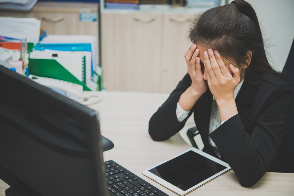 stock photo of woman frustrated at work.