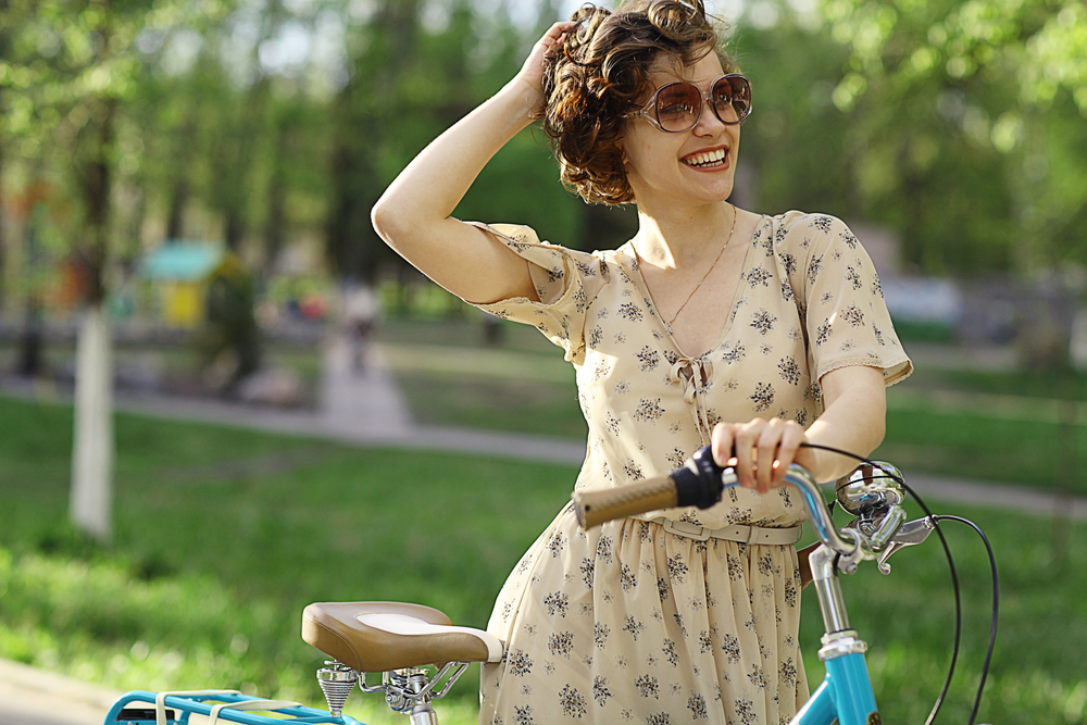 cheerful girl with bicycle
