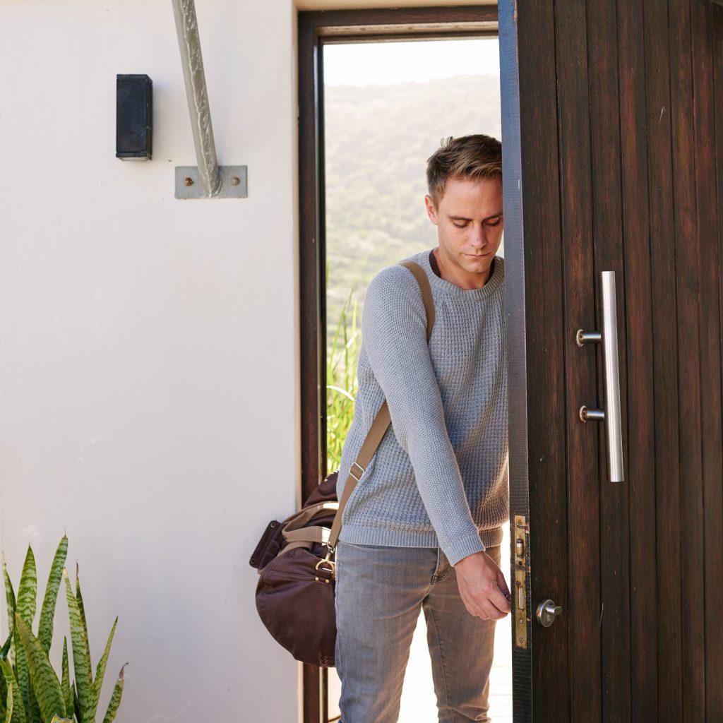 Man Walking into Home