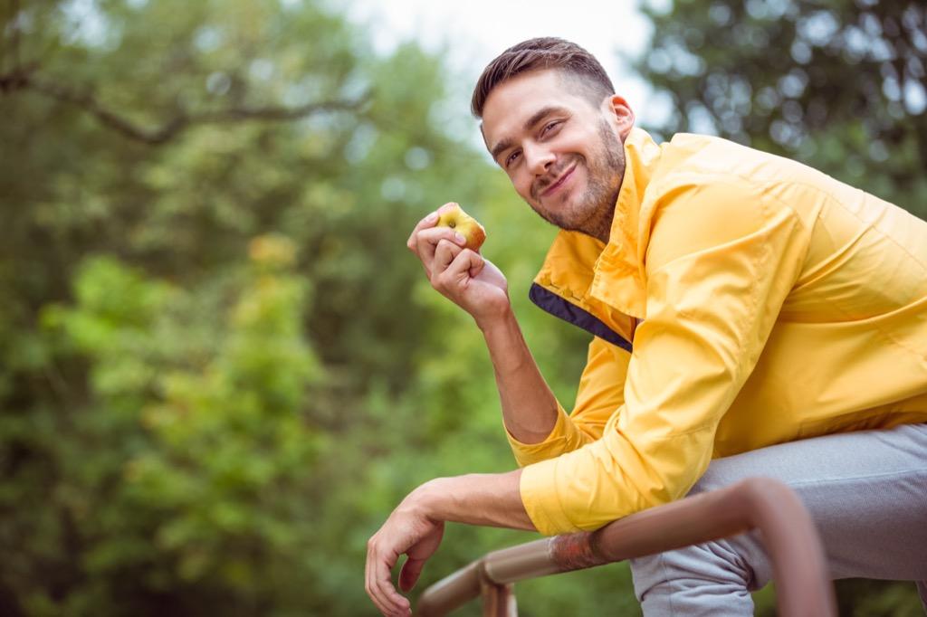 man eating apple , Worst Men's Health Myths