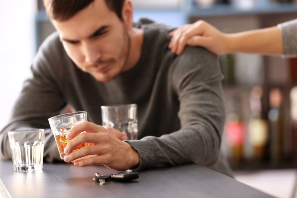 alcoholism and the brain - image of a man who can't stop drinking