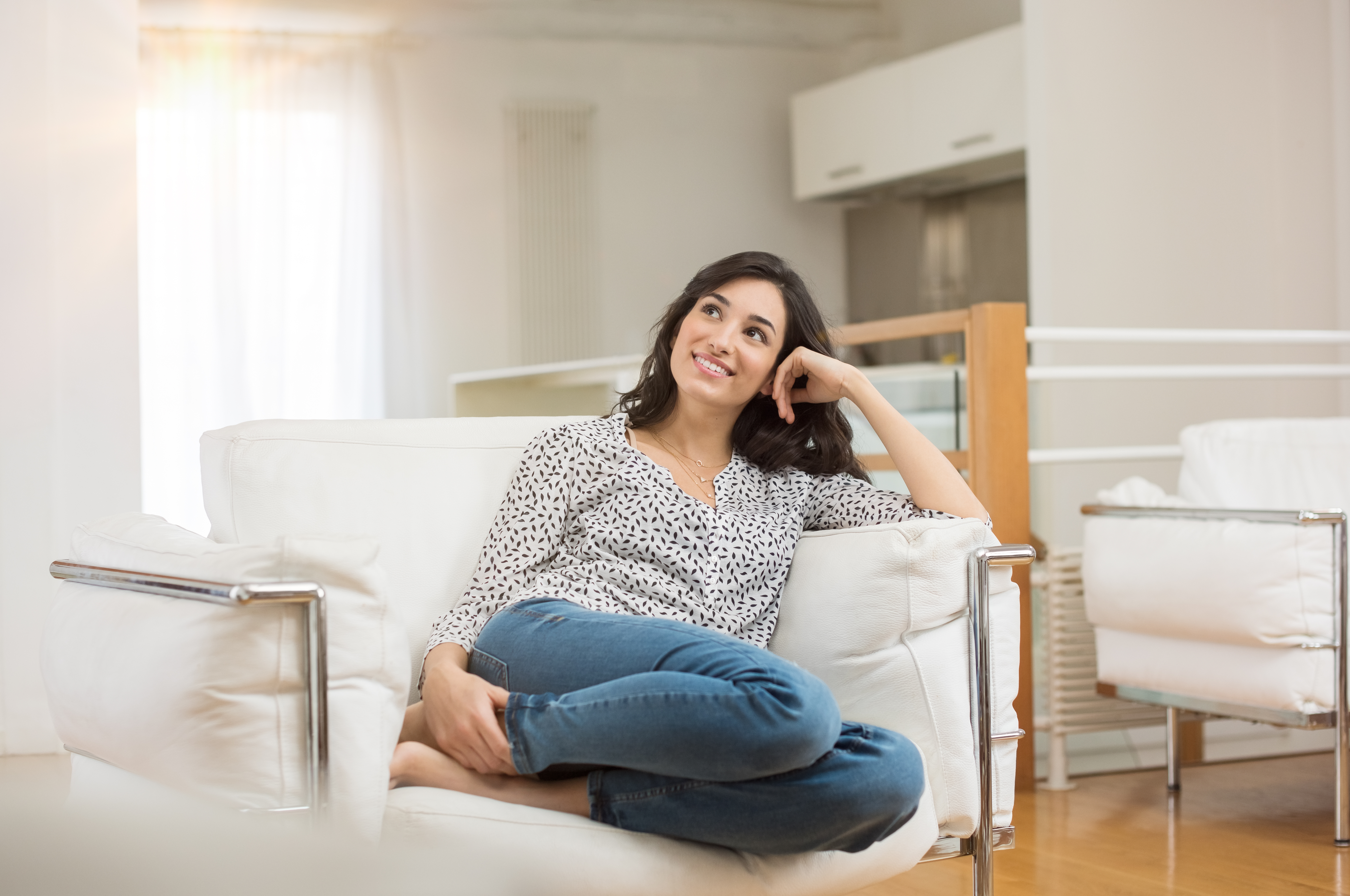 Confidence / Woman Sitting on Couch Smiling