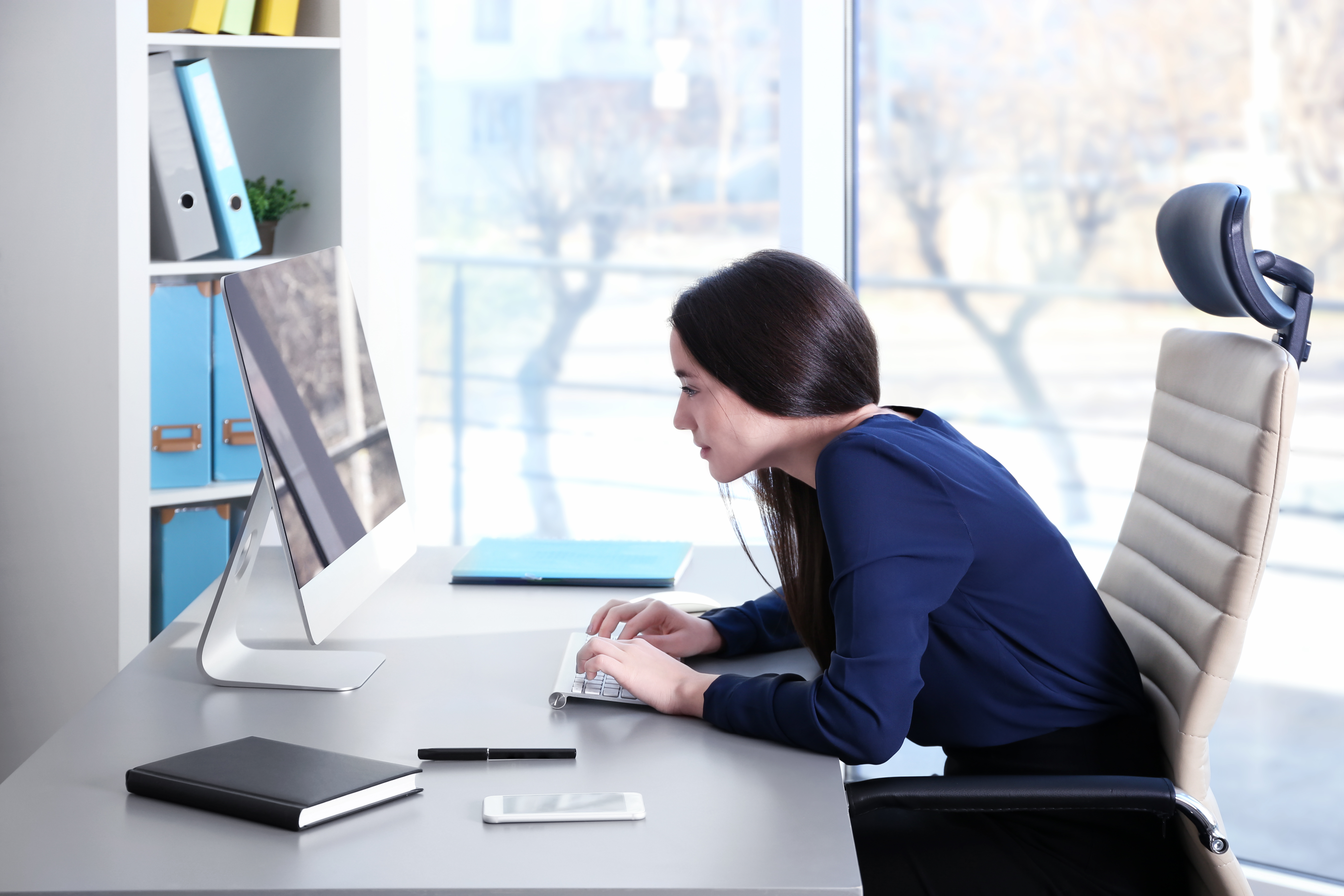 Confidence / Woman Sitting at Desk with Bad Posture