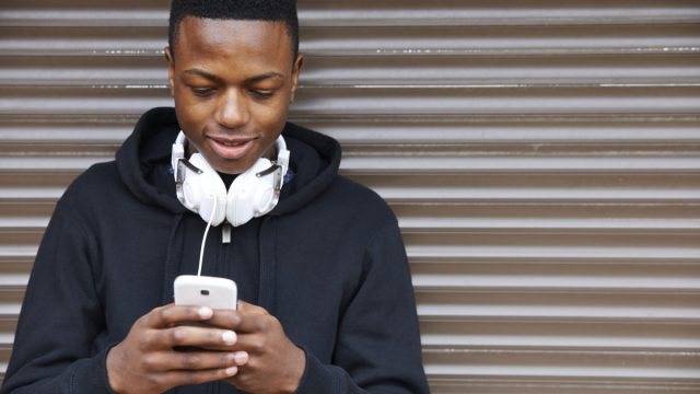 teenager on smartphone differences between millennials and generation z