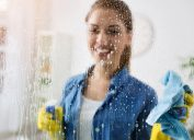 woman cleaning window, working mom