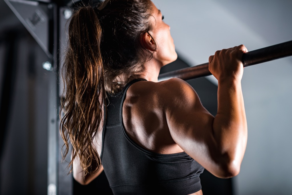 woman doing pull up exercise myths