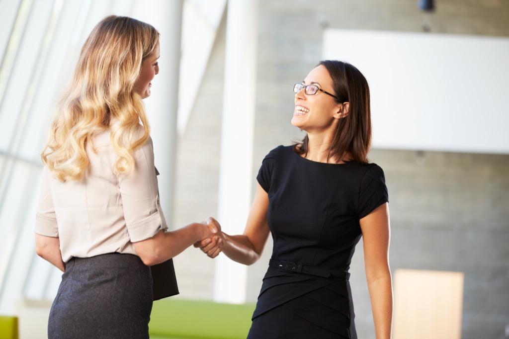 promotion women shaking hands