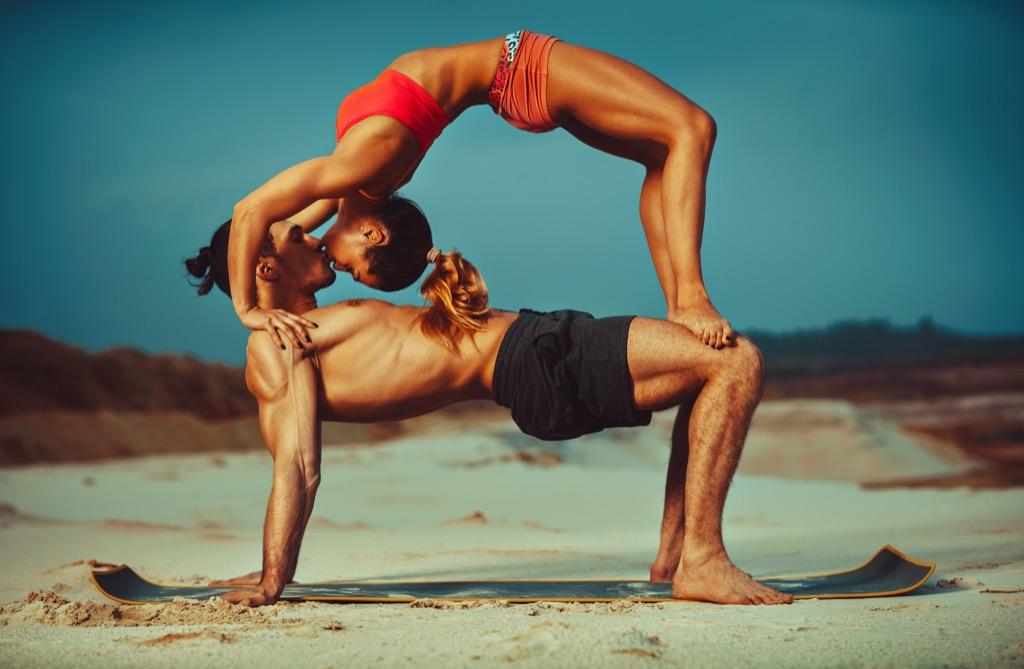 couple doing yoga, date night ideas