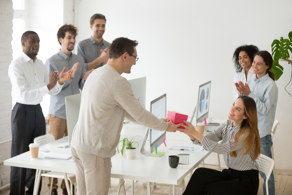 Coworker Giving Gift Workplace Stress-Busters