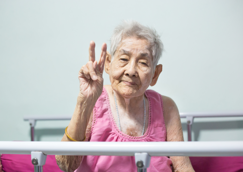 Elderly Woman Holding Peace Sign Yo Mama Jokes suicide forest