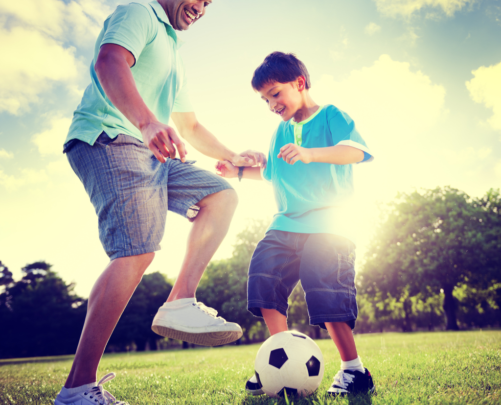 Father and Son Playing Soccer Parenting