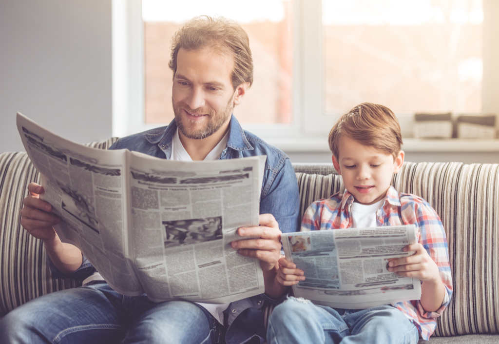 Father and Son Reading Newspaper Parenting